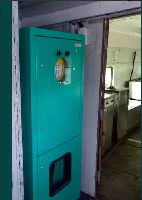 Bottle Crushing Machine in the Pantry Car of Trains